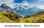great view of eiger village.... | Shutterstock . vector #582496054