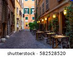 view of old cozy street in rome ... | Shutterstock . vector #582528520