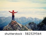 successful woman backpacker... | Shutterstock . vector #582529564