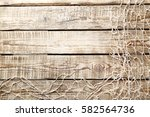 Fishing net on brown wooden table - stock photo