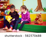 cute girls talking and playing... | Shutterstock . vector #582570688