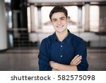 handsome young man smiling... | Shutterstock . vector #582575098