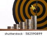 yellow dart hit in the center... | Shutterstock . vector #582590899