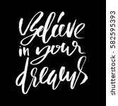 believe in your dreams. hand... | Shutterstock .eps vector #582595393