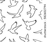 birds silhouettes   flying... | Shutterstock .eps vector #582602794