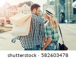 young happy couple with... | Shutterstock . vector #582603478