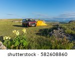 red suv and yellow tourist tent ...