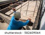 worker placing cement floor in... | Shutterstock . vector #582609064