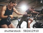 Stock photo sportive people while cardio training in gym horizontal indoors shot 582612910