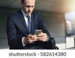 confident handsome businessman... | Shutterstock . vector #582614380
