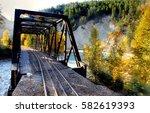 railroad crossing the river... | Shutterstock . vector #582619393