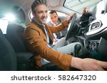man sitting inside vehicle in... | Shutterstock . vector #582647320