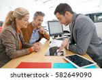 salesman in car dealership and... | Shutterstock . vector #582649090