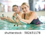 Couple In Swimming Pool Doing...