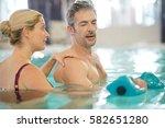 man in spa pool doing exercises ... | Shutterstock . vector #582651280