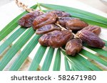 dried dates fruit on wooden... | Shutterstock . vector #582671980