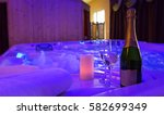jacuzzi  champagne and candle... | Shutterstock . vector #582699349