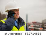 construction engineer using... | Shutterstock . vector #582714598