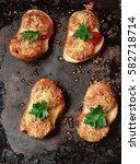 delicious bruschetta with meat... | Shutterstock . vector #582718714