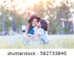 happy family on a summer meadow ... | Shutterstock . vector #582733840
