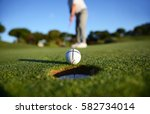 golf ball dropping into the... | Shutterstock . vector #582734014