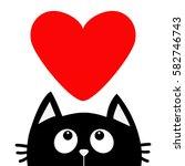 black cat looking up to big red ... | Shutterstock .eps vector #582746743