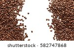 coffee beans isolated on white... | Shutterstock . vector #582747868