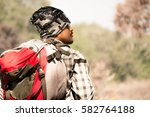 a backpacker with red bag