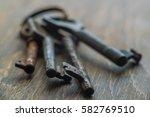 vintage keys on wooden... | Shutterstock . vector #582769510