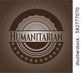 humanitarian badge with wood... | Shutterstock .eps vector #582777070