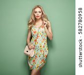 blonde young woman in floral... | Shutterstock . vector #582780958