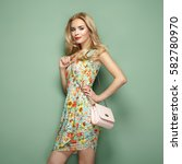 blonde young woman in floral... | Shutterstock . vector #582780970