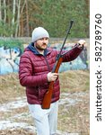 Small photo of Man Shooting from a gun. Training shooting from an air rifle.