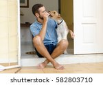 a man and a dog. man sitting on ... | Shutterstock . vector #582803710