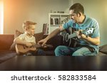 father teaching his son to play ... | Shutterstock . vector #582833584