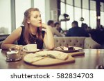 young adult girl in cafe | Shutterstock . vector #582834703