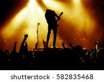 silhouette of guitar player in... | Shutterstock . vector #582835468