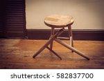 broken wooden stool in... | Shutterstock . vector #582837700