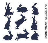 9 silhouettes of bunnies in... | Shutterstock .eps vector #582838570