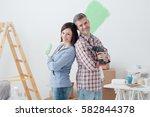 smiling loving couple doing... | Shutterstock . vector #582844378