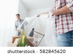 two people preparing a room for ... | Shutterstock . vector #582845620