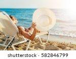 beautiful young woman enjoying...   Shutterstock . vector #582846799