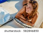 beautiful smiling girl enjoying ... | Shutterstock . vector #582846850