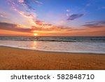 sunset on the beach of... | Shutterstock . vector #582848710