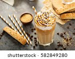 iced caramel latte coffee in a... | Shutterstock . vector #582849280