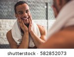handsome naked afro american... | Shutterstock . vector #582852073