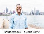 portrait of happy black man... | Shutterstock . vector #582856390