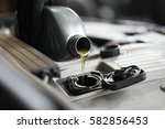 a technician in the workshop... | Shutterstock . vector #582856453