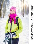 woman hiking in winter forest... | Shutterstock . vector #582858004