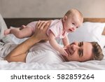 handsome young dad is playing... | Shutterstock . vector #582859264